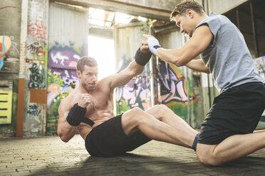 Two young men having a boxing workout - MADF000847