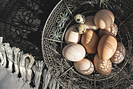 Wire basket of quail egg and brown chicken eggs - DEGF000690