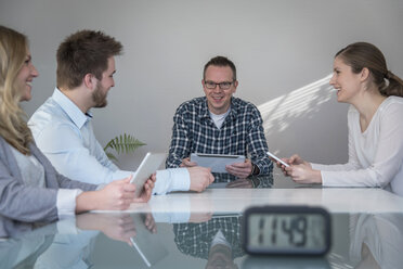 Four smiling colleagues having a meeting - PAF001581