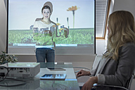 Woman leading a presentation with projector in conference room - PAF001584