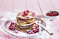 Stack of American pancakes with  red currents sprinkled with icing sugar - SBDF002706