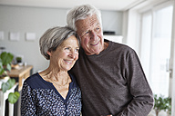 Portrait of happy senior couple at home - RBF004136