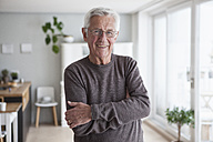 Portrait of smiling senior man at home - RBF004142