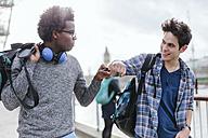 UK, London, two best friends bro greeting - BOYF000116