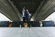 UK, London, two young man junping in the air - BOYF000128