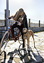 Young woman with bicycle and greyhound - MGOF001489