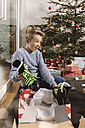 Little boy unwrapping a Christmas gift - MFF002754