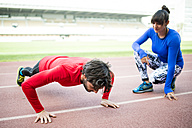 Athletes training for race in stadium - KIJF000212