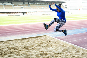 Female athlete training for long jump in stadium - KIJF000227