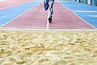 Female athlete training for long jump in stadium - KIJF000230