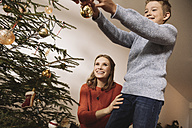 Mother and son decorating Christmas tree - MFF002801