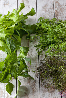 Different sorts of wild turnip and  green pepper basil on wood - CSF027284