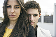 Portrait of serious young couple outdoors - ABZF000273