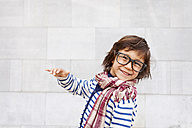 Portrait of laughing little boy wearing scarf and oversized glasses - VABF000322