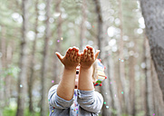 Little boy catching confetti in the woods - VABF000334