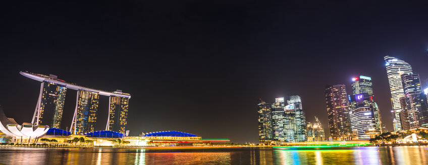 Singapore, view to Marina Bay Sands Hotel and high-rise buildings at night, panorama - LEF000002