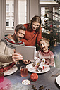 Family using digital tablet during Christmas - MFF002832