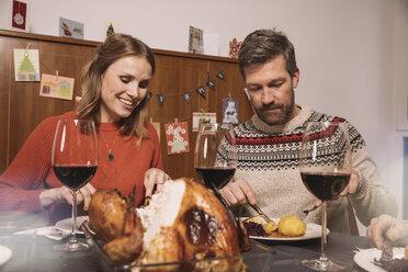 Couple having Christmas dinner - MFF002853