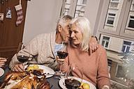 Affectionate senior couple during Christmas dinner - MFF002856