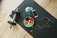 Dumbbell, drinking bottle, fruit bowl and smartphone with earphones - EBSF001258