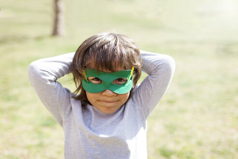 Portrait of little boy wearing green eye mask - VABF000345