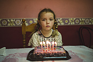 Portrait of sad little girl with birthday cake - RAEF000934