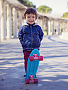 Portrait of smiling little boy with skateboard - XCF000063