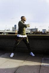 UK, London, runner having a break at riverwalk - BOYF000132