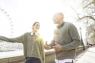 UK, London, two runners talking at riverwalk - BOYF000135