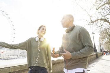 UK, London, two runners talking at riverwalk - BOYF000135