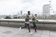 UK, London, man and woman running at riverwalk - BOYF000144