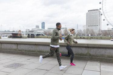 UK, London, man and woman running at riverwalk - BOYF000144