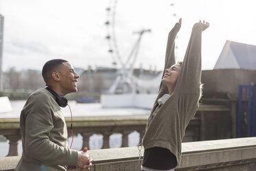 UK, London, two runners talking at riverwalk - BOYF000147