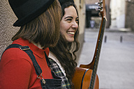 Two young women with guitar having fun - ABZF000284