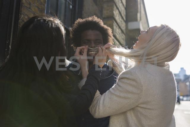 Three friends having fun on urban street - BOYF000175