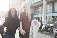 Two female best friends having fun on urban street - BOYF000193