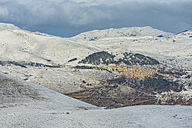 Italy, Abruzzo, Gran Sasso e Monti della Laga National Park,  The town of Castel del Monte in winter - LOMF000239