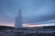 Iceland, Strokkur geyser with Langjoekull glacier in background - PAF001650
