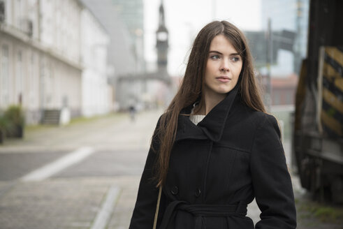 Young woman wearing black coat outdoors - LFOF000202