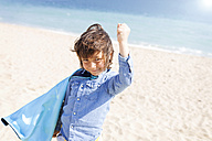 Portrait of little boy with blue cape playing superhero - VABF000362