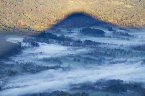 Germany, Upper Bavaria, morning fog in Isar valley, shadow of mountain, view from Geierstein - SIEF006984