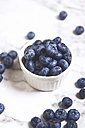 Bowl of blueberries on white marble - RTBF000001