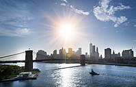 USA, New York City, view to Brooklyn Bridge at backlight - HSIF000421