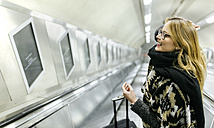 Young woman on subway escalators - MGOF001542