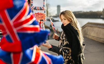 UK, London,  young woman looking at a souvenir stall - MGOF001551