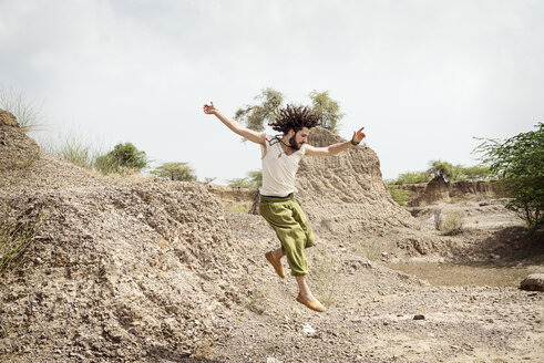 Man jumping in landscape - BMAF000111