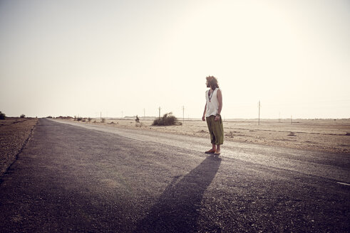 Man travelling alone on country road - BMAF000123