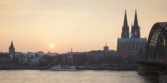 Germany, Cologne, view to the old town and Cologne Cathedral by sunset - WIF003290