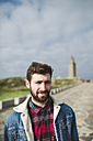 Spain, A Coruna, portrait of young man with brown hair and full beard - RAEF000942