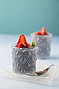 Glasses of Mousse au Chocolat garnished with raspberries, strawberries and hardy kiwi - MYF001411